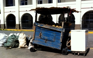 The coconut vendor's stall outside my office. Yes, he will sell almost all of those bagged coconuts in one day.