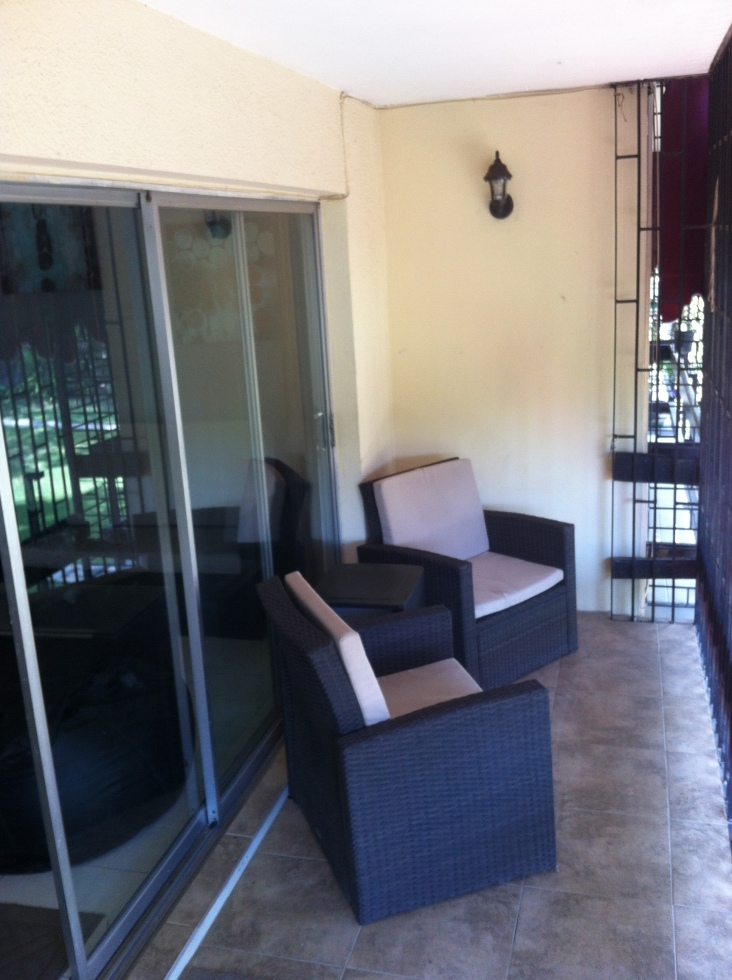 The rest of the patio set (though you can't see the fugly leather sofa leaning against the end wall)